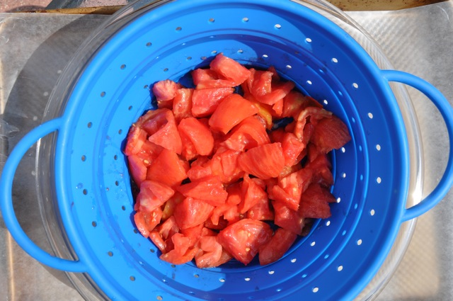 Draining tomatoes for fresh tomato pie at ThePieAcademy.com