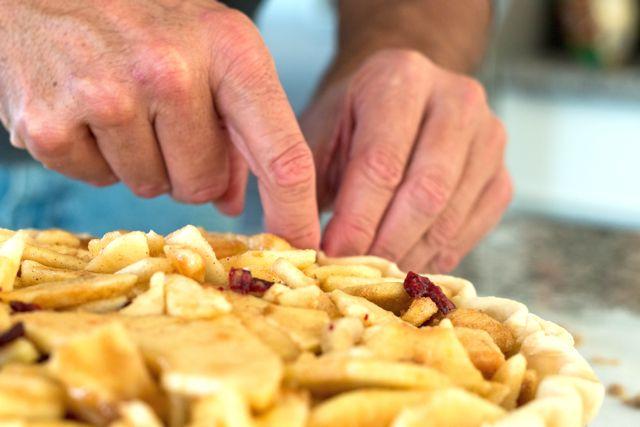 Hands on the apple pie