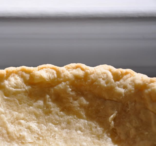 A partially prebaked pie shell